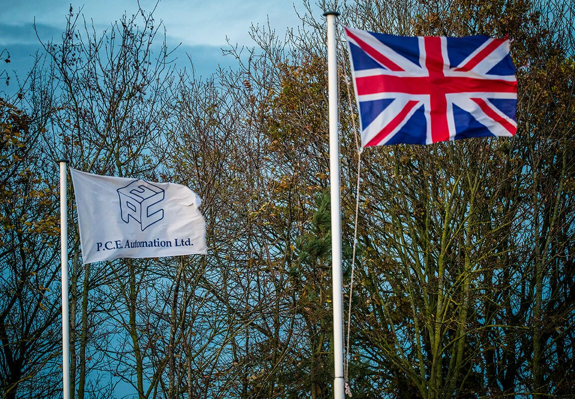 PCE Flag and Union Jack fly at full mast